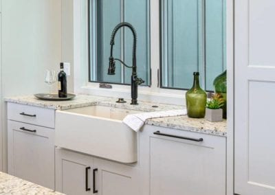 Large kitchen basin with sprayer hose faucet