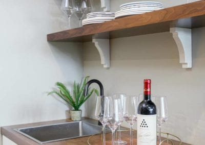 wine station with sink and shelving