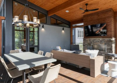 Living Stone Design+Build Screened in Porch with TV