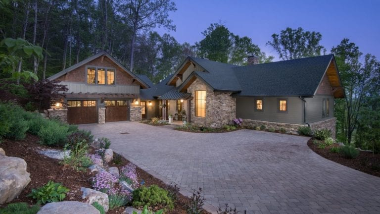 living stone fletcher home with custom brick drive