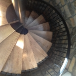 Three story spiral stair case